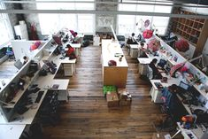 Scenes From The Office .... neat loft space, but also very bare ... I like that each desk has a parasol :)