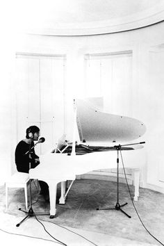 John Lennon recording Imagine at his home in Tittenhurst Park, The song was released on the album of the same name on September Ex-Beatle George Harrison also performed on many of the tracks. Imagine John Lennon, John Lennon Yoko Ono, Ringo Starr, George Harrison, Paul Mccartney, John Lennon Albums, Beatles Albums, Imagine Album, The Beatles Story
