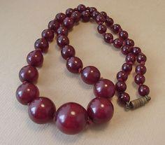Art Deco Round Cherry Amber Bakelite Graduated Bead Necklace.