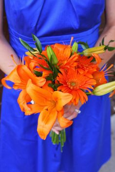orange and blue wedding: Asiatic lilies and gerbera daisies