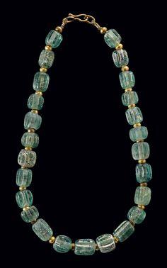 A ROMAN GLASS BEAD NECKLACE -  CIRCA 200 B.C.-100 A.D.