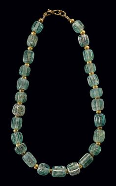 A ROMAN GLASS BEAD NECKLACE -  CIRCA 200 B.C.-100 A.D.