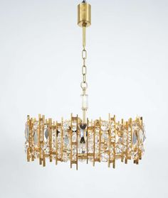 Gilded Brass and Crystal Glass Lobmeyr Chandelier | From a unique collection of antique and modern chandeliers and pendants  at https://www.1stdibs.com/furniture/lighting/chandeliers-pendant-lights/