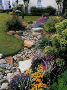 Many homeowners wanting a dry creek bed often end up with a drainage ditch. For ideas along with form and function [LEARN MORE]