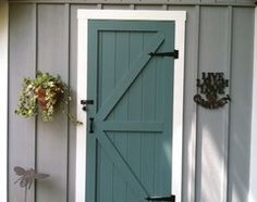 9 Daring Colors for Your Front Door Garden shed with door in Caribbean Teal by Benjamin Moore. Siding is Timber Wolf by BM. Planning to use the same door color on my white house with Gray BM shutters.