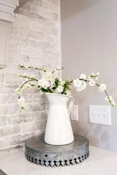 Joanna kept the exposed brick in the kitchen intact but painted it in white with a light wash finish.