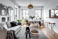 Love the styling of this apartment by @stylingbolaget  @henriknero for @bosthlm_realestate - the two tone lamp, mismatched wishbone dining chairs, that round mirror beside the b&w prints - it just works ✔️ Hope my Aussie followers had a lovely Australia Day