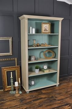 This farmhouse pine bookcase has been painted in Annie Sloan Country Grey with a lightened version of Provence inside. This living room staple is the perfect place to store your books and ornaments, with subtle pastel colours and pretty detailing. http://www.thetreasuretrove.co.uk/cabinets-and-storage/shabby-chic-pine-bookcase-with-bun-feet