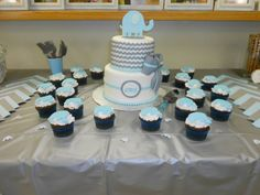 My baby shower cake with matching cupcakes!!