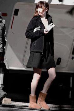 Dakota Johnson wearing Ugg Australia Classic Short Boots in Chestnut and Helly…