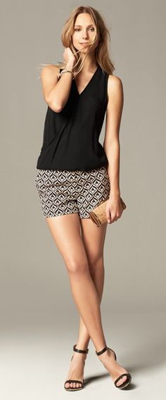 Black top and printed shorts with strappy sandals - super cute, but classy.  Perfect for summer night date outfit! | Banana Republic