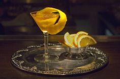 Sundowner 3 oz Beluga Noble Russian Vodka 1 oz gin .5 oz Rouge Lillet Garnish with an orange twist.
