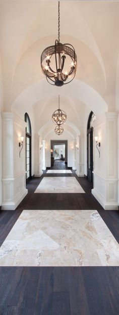 Love the white marble with dark hardwood floors.!
