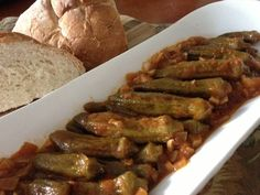 Okra (μπάμιες) Vegan, gluten free Oh how I love okra! Tender, sweet with a big piece of crusty bread to sop up the garlicky good sauce and you've got yourself a Greek vegan good meal. Okra Recipes, Veggie Recipes, Whole Food Recipes, Vegetarian Recipes, Cooking Recipes, Healthy Recipes, Vegan Meals, Recipies, Bon Appetit