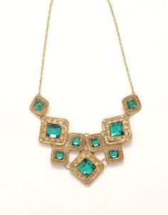 Dazzling gold bib necklace with diamond shaped green rhinestones. Great for prom night