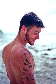 Hammerhead Shark Tattoos on the Beach. Hot men with tattoos. Handsome men, and good looking fellas.