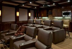 Havens South Designs looks for comfortable media rooms of a reasonable size. This room is 26' end to end and 18' wide. Sound quality improves if surfaces and furnishing are not square or flat.  Sound panels in ceilings and on walls are critical.