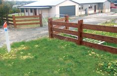 Click on image to go back - Post and 3 rail fence constructed with cypress pine