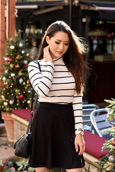 Get the look: Maison Jules Striped Turtleneck and skater skirt. Ivanka Trump boots