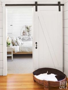 Instantly transform your space with a sliding barn door. This farmhouse project may seem daunting but just wait until you see how easy it can be! - April 20 2019 at Barn Door In House, Wood Barn Door, Diy Barn Door, Barn Door Hardware, Wood Doors, Door Hinges, Steel Doors, Door Brackets, Metal Barn