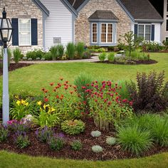 I could put something like this planting idea surrounding my trees in the front yard.  Traditional Landscape Design Ideas, Pictures, Remodel, and Decor - page 97