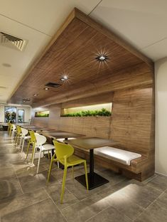 Coffee Shop Design | Retail Design | Cafe seating : beautiful wood. great idea for the plants