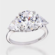 4.0 Ct. Round   with .55 carat trillion on each side - 14K Three Stone Ring