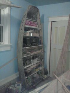 Boat bookshelf. My grandfather built this in the 40's and when no longer seaworthy, it became a shelf in my shop.