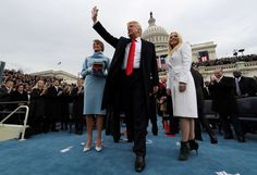 Pictures of the year: President Trump - President Trump acknowledges the audience after taking the oath of office as his wife Melania and da... - REUTERS/Jim Bourg