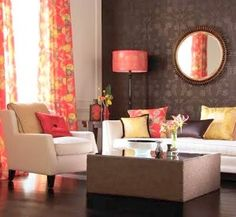 An accent of burnt oranges in a foliage pattern brings a brown & neutral room to life.
