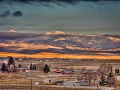 Morning sun and low clouds over the Pioneers - Dillon, MT (by Dick Smith)