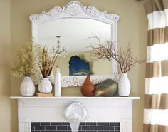 fall mantle decor in white/pale.  Who knew?  Also a pic done with pale blue.