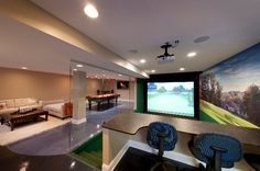 "On The Green - The ceiling in the planned indoor golfing range was too short to accommodate a full swing. Thus began a complete redo of the basement, which started by excavating the floor. ""Per our specifications, the contractor had to dig down about 3 feet to create a 10-foot-tall ceiling,"" says Pope. System design and installation by Audio Video Interiors in Middleburg Heights, Ohio. Photo by Howard Tucker. http://www.electronichouse.com/article/golf_billiards_and_home_cinema_meet_here/"