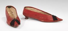 "Slippers ca. 1790-1810 via The Costume Institute of the Metropolitan Museum of Art  ""Sharply pointed slippers with tiny heels were the prevalent style in the 1790s and 1800s. This pair features the red Morocco leather much favored at the time and a tiny heart-shaped buckle threaded with silk twist to form a jaunty tassel. Particularly notable to shoes of this period is the distinctive shape of the sole with its wide ball and narrow waist. Tiny, meticulous stitching in contrasting thread acc"