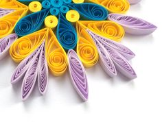 Snowflake Purple Yellow Blue, Quilled Handmade Art, Paper Quilling, Home Decoration Idea, Christmas Tree Decor, Winter Ornaments. You can hang it on Christmas tree, use as fridge magnet, decorate Your bookshelf, dinner table or put it in lovely frame. Also can make an excellent addition to Christmas presents! Dimensions - 4 ″ x 4 ″ (10 cm x 10 cm) - a nickel (5 cent coin) for scale. Made from 1/4 ″ (5 mm) paper strips of 90 g/m2 paper.