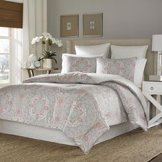 This elegant comforter set is crafted with 100 percent cotton sateen and offers the ease of machine care. The red and grey medallion pattern is sure to complement your decor.