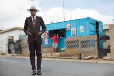 On the Street….The Smarties, Soweto, SA « The Sartorialist  ~This young man designs and sews his wardrobe...he bought this suit at a second-hand store and had it altered to fit his body and his style.