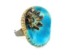 Aqua ceramic ring with golden brown flower