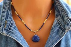 Lapis Necklace, Gold and Lapis Beaded Necklace, Boho Chic Blue Beaded Necklace, Gemstone Beaded Necklace, Womens Beaded Necklace Full of bohemian style and eye-catching allure this Tam Davis lapis pendant necklace can be as casual or as dressy as you like. The plump drop of deep blue
