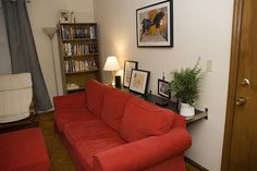 Two floating Ikea shelves behind a couch.