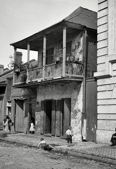 """New Orleans circa 1880s-1890s. """"Street in the French Quarter."""" 5x7 glass negative by William Henry Jackson. Attribution based on Catalogue of the W.H. Jackson Views (1898). Shorpy Historic Picture Archive :: Old Orleans: 1890 high-resolution photo"""