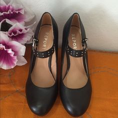 """Black buckled heels Black elegant with studs and buckle strapped shoes.Stainless steel metal buckle.Size 9 and 4"""" heels. Looks good as new , good condition and clean.By:Report Report Shoes Heels"""