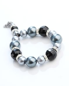 Vi Bella Jewelry - Midnight bracelet - A night out? A night in? Do both in style! The Midnight Bracelet consists of multifaceted black beads, grey pearls, and rhinestone bejeweled silver beads with a dangling little accent of similar beads all strung on a stretch cord. Wear with the Midnight necklace and Midnight Earrings.  Dazzling!     Length - 7.5 Inch Stretch     Handcrafted by Vi Bella Artists in Haiti.  $24.95