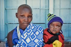A portrait of a Maasai mother and her beautiful big eyed son. I do love the tribal colors of the Maasai people.