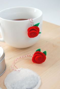 Felt Rosettes on Tea Bags. What a pretty DIY gift for Valentine's Day or Mother's Day.