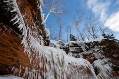 Description of . Needle-like icicles fill Lake Superior's mainland cliffs in the Apostle Islands National Lakeshore. Waterfalls, underground springs and wave water have all helped sculpt the spectacular formations. (Pioneer Press: Andy Rathbun)