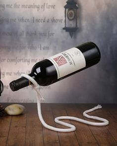 Magic Wine Bottle Holder makes it look as if a flimsy piece of rope is supporting the full weight of a wine bottle in mid air! Fun gift for wine lovers.