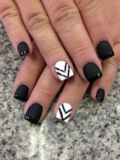 We love this matte black nail polish mixed with a white nail art design. Dress it up or down!