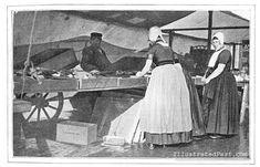 Dutch Women in Traditional Dress Shopping At the Fair