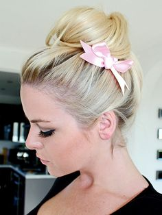 loose top knot bun with a bow on the side -- such a fun and easy updo for medium to long hair